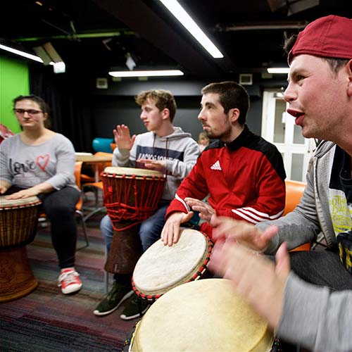 A group playing bongos